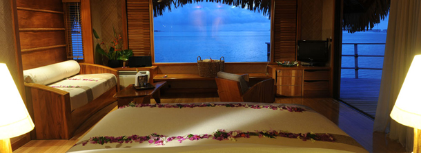 polynesian bungalow with water view