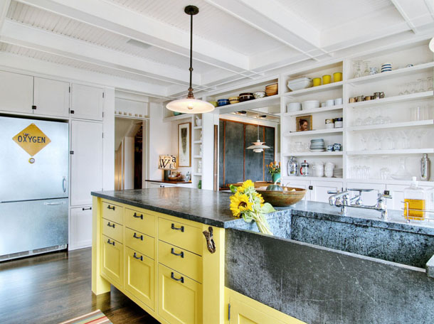 Eclectic white kitchen with yellow base cabinets and open shelves
