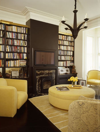 eclectic living room with built-in shelves and yellow upholstered furniture