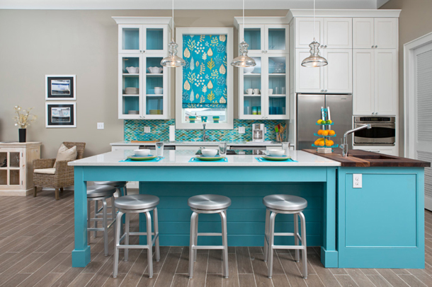 turquoise cabinets in a light gray and white kitchen