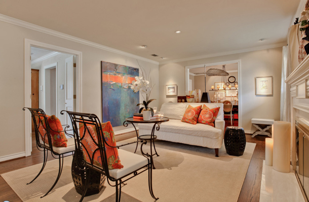 interior with off-white walls and orange accents