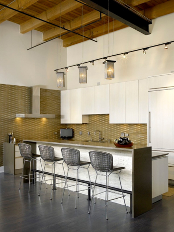 ochre backsplash in white kitchen with gray and black accents, metal mesh barstools