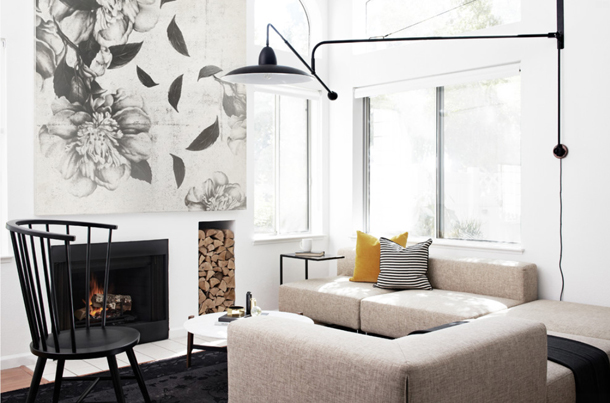 living room with individual white furniture, black and white art, black lighting, black fireplace, black accent chair