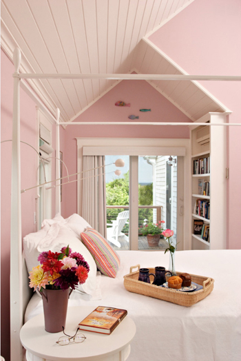 pale pink bedroom with white ceiling and accents