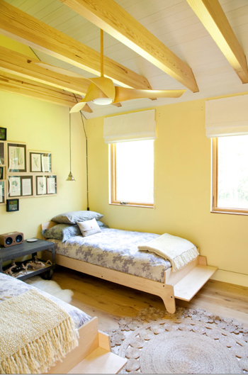 light yellow bedroom, exposed natural wood beams, natural wood beds