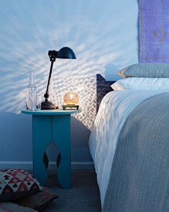 light blue bedroom, candle reflection on wall