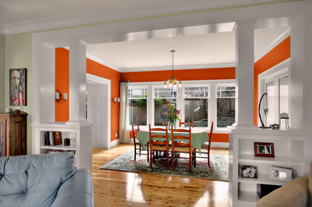 burnt orange dining room with white trim