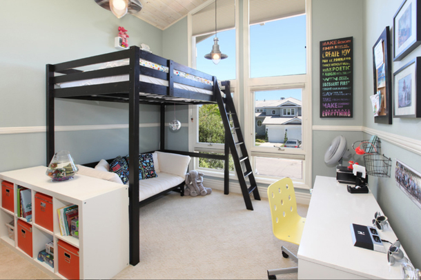 kids bedroom, pale yellow desk chair, black loft bed, gray walls, window wall