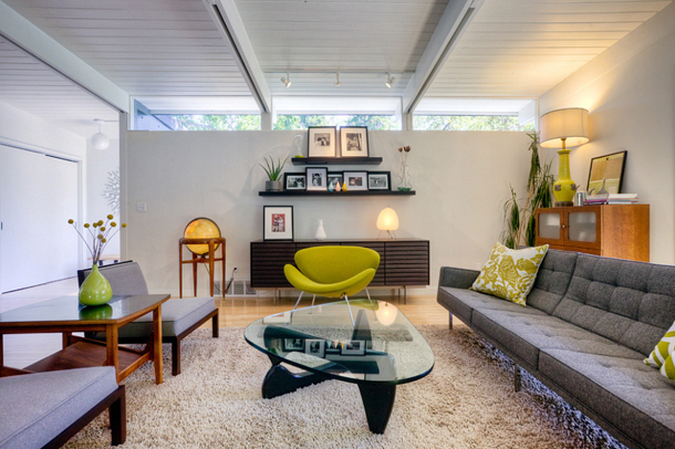 mid-century modern living room, clerestory windows, white walls, grey upholstery, green-gold accents