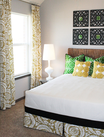 bedroom with green and gold accents