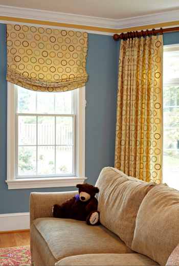 interior with slate blue walls, beige sofa, brown teddy bear, white trim