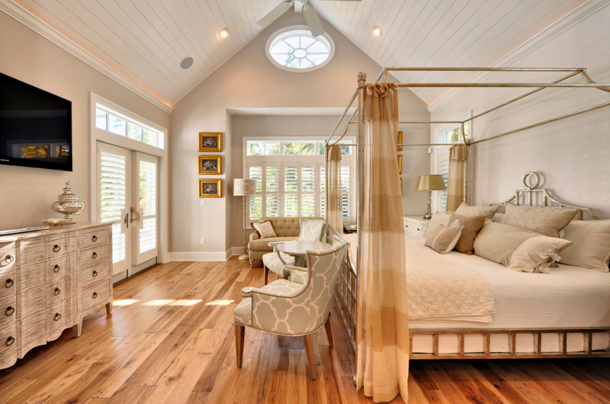 bedroom with pale gray walls and light wood floors