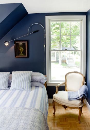 navy blue bedroom with white window trim