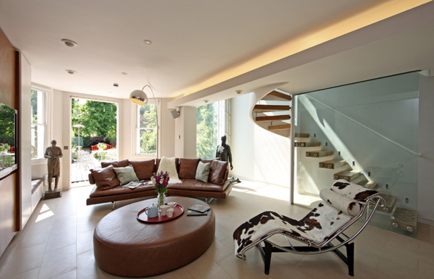 modern family room with open stairs and hidden cove light