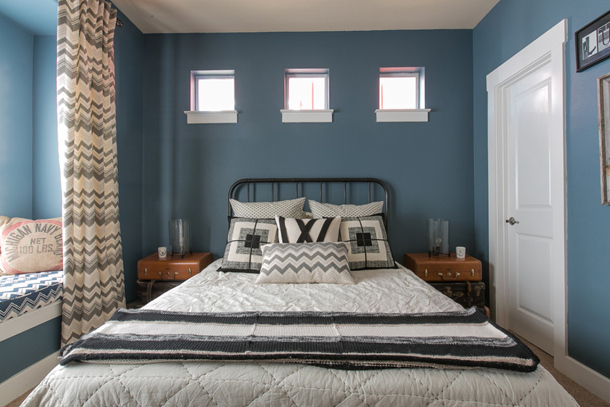 cozy bedroom, slate blue walls, clerestory windows above bed, square windows, black and white bedding, window seat