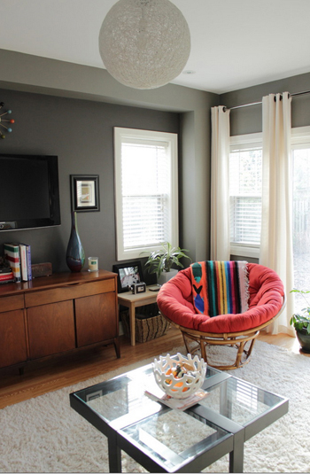 gray living room with red papasan chair