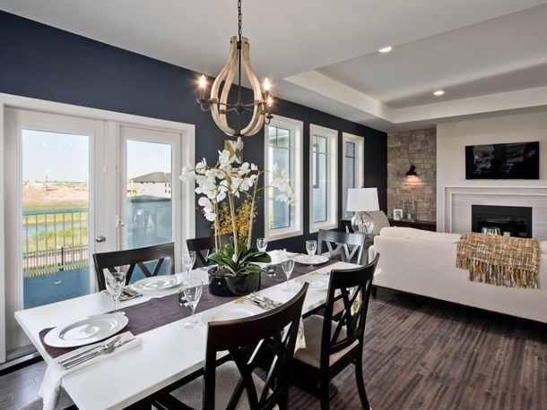 dark navy and white living area, dark wood floors, black accents