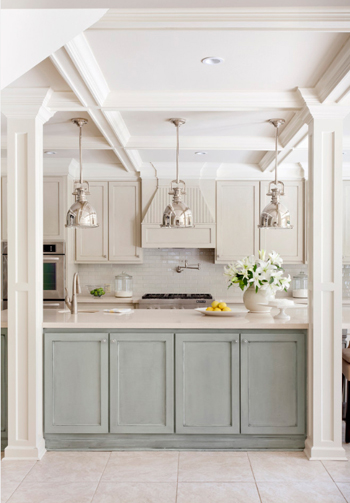 bright off-white kitchen with pale blue island cabinets