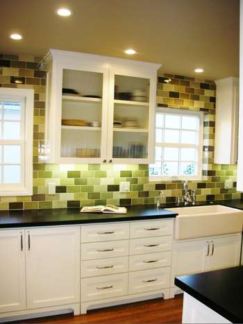 white kitchen with multi-colored green tile backsplash