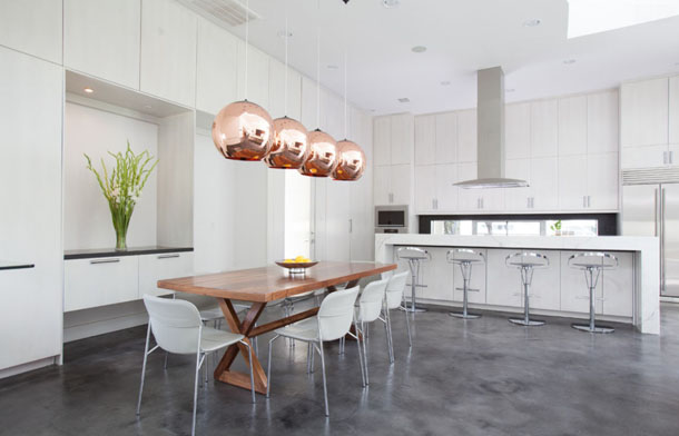 modern kitchen, white kitchen, white dining chairs, wood farm table, copper pendant lights, stained concrete floor