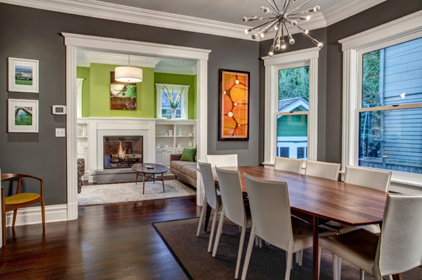 charcoal gray dining room with white trim