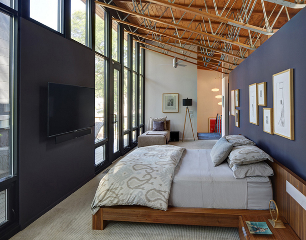 modern bedroom, dark purple accent walls, glass wall, platform bed, exposed wood ceiling
