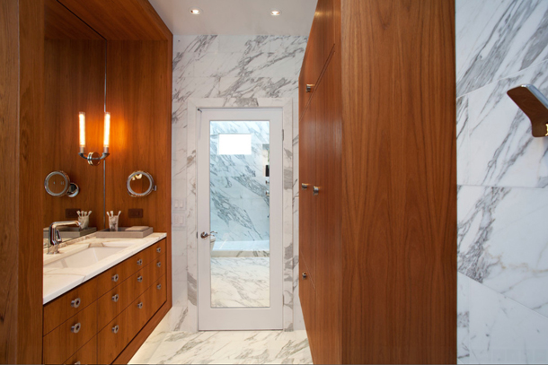 white granite bathroom, warm brown wood cabinets, modern bathroom design