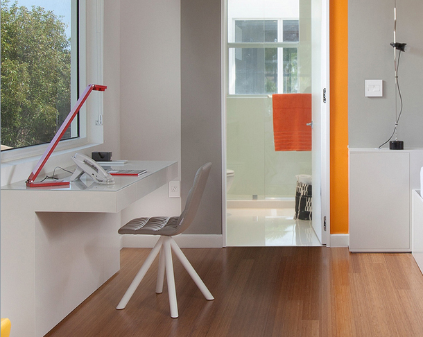 home office with bright orange accent