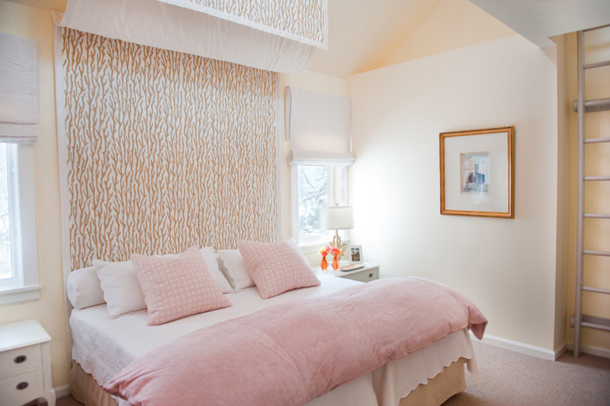 pale pink bedroom, build-in ladder to loft, hanging fabric headboard