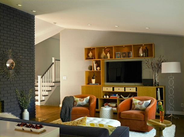 living room with dark gray brick accent wall