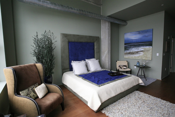 gray bedroom with royal blue accents