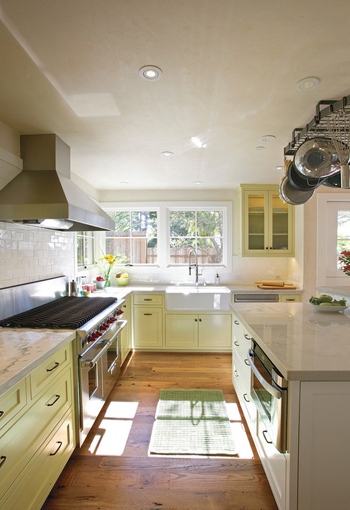 white kitchen with light yellow cabinets
