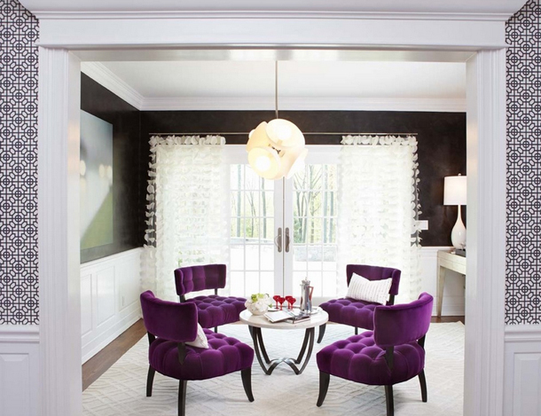 purple-black living room, white wainscot, white carpet, white draperies, bright purple chairs