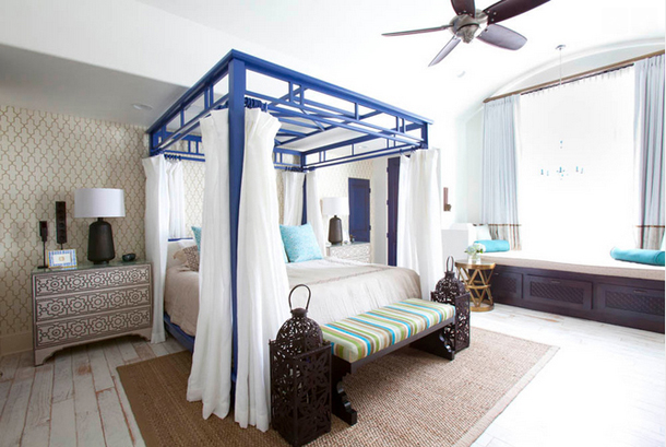 cobalt blue canopy bed, white draperies