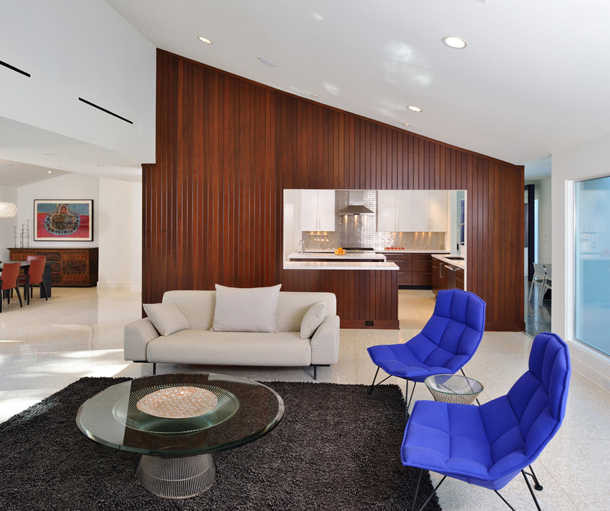living room with royal blue accent chairs, wood accent wall