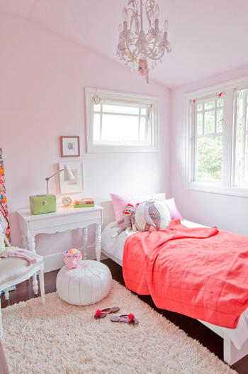pale pink bedroom with coral bedding