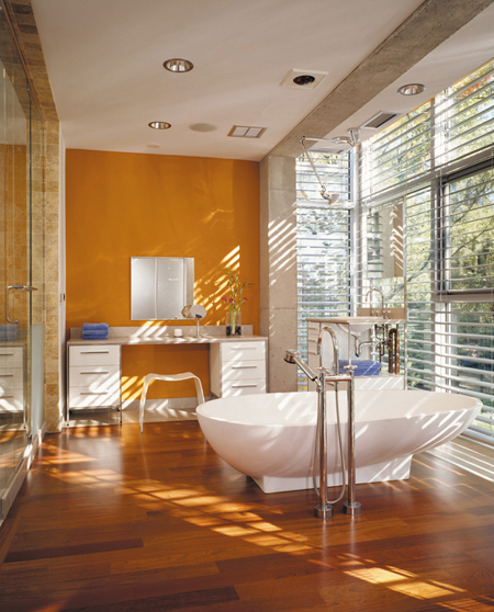 modern bathroom, wood floor, butterscotch accent wall, freestanding tub, window wall