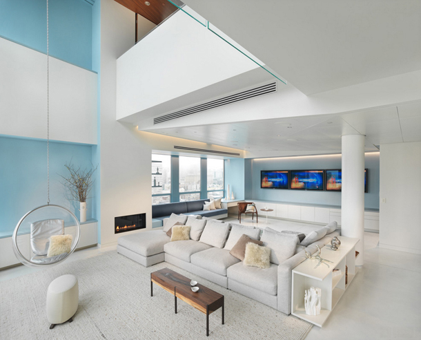 white modern living room, pale blue accent walls, two story living room