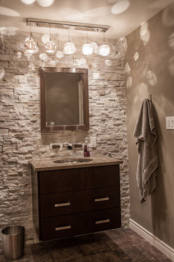 gray powder room, stone accent wall, modern dark wood vanity cabinet