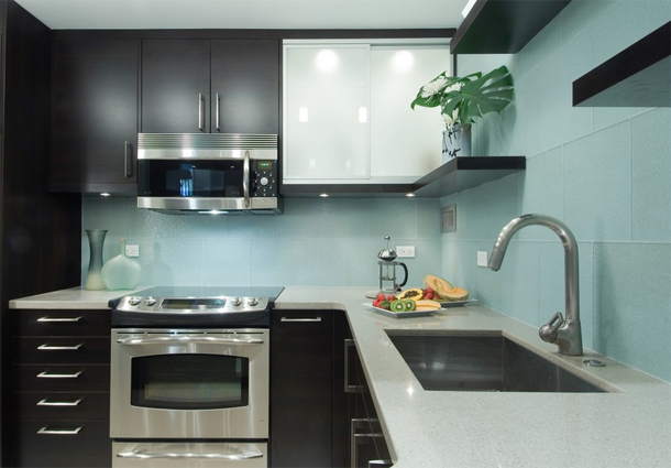 modern kitchen design, dark cabinets, light countertop, aqua blue tile backsplash, large format tile backsplash