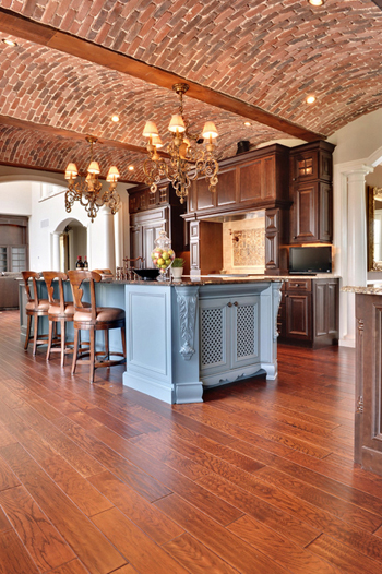mediterranean style kitchen, curved brick ceiling, pale blue island