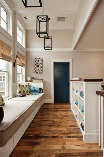 beige hall, built-in window bench, wood floors, blue door, white trim