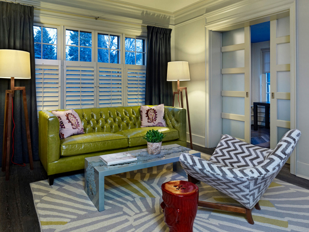 gray living room, lime green sofa, gray and white chevron upholstered chair, sliding pocket doors, wood doors with glass panels