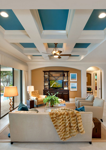 white living room, coffered ceiling, teal ceiling accents, gold throw blanket