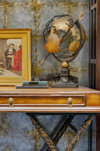 gold patina console, gold picture frame, gold patina metal globe, gold and gray patina wall finish