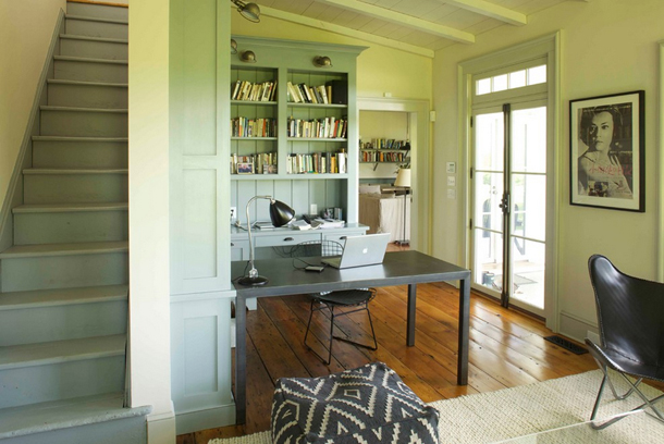 19th century farmhouse renovation, gray-green built-in shelves, wood floors, black accents, french doors