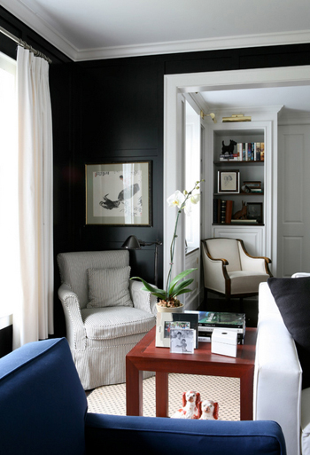 dark living room with white trim