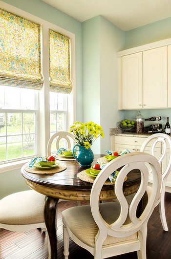 pale seafoam green walls, kitchen, cream cabinets, cream dining chairs, wood floors