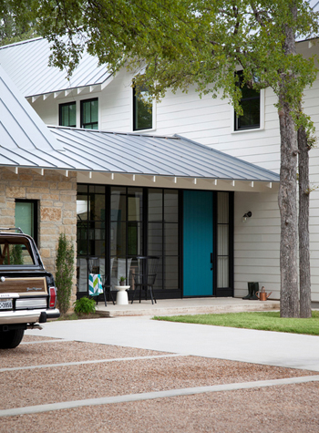 home exterior, white siding, teal blue accent door, black window frames
