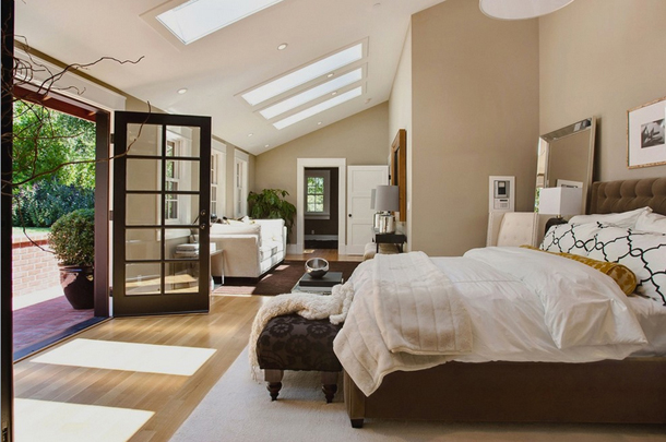 beige bedroom with black and white accents